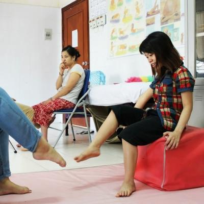 A female intern is pictured gaining physiotherapy work experience whilst assisting locals affected by Agent Orange during her physiotherapy internship in Vietnam.